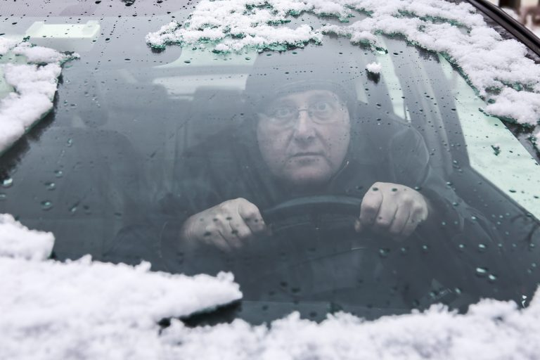 Driving peers through a gap in his snow-covered windscreen