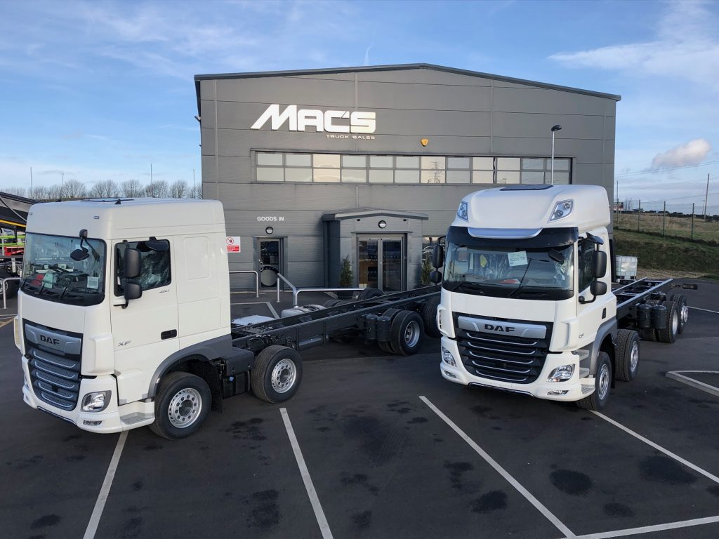 two 2019 DAF Beavertail Trucks outside the Macs Trucks building